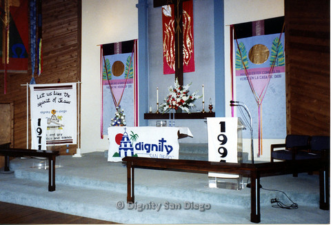 "P103.140m.r.t Ground view of Dignity San Diego church alter with banners reading ""1971"" and ""1991"""
