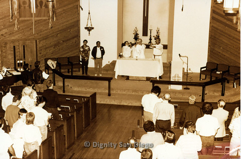 P103.055m.r.t Dignity San Diego: Religious leaders and congregation standing for the presentation of communion