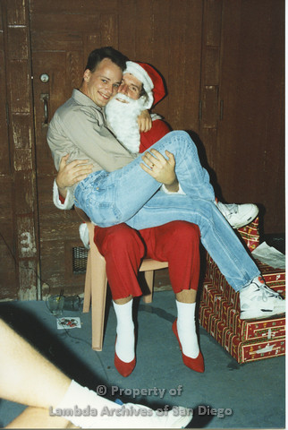 P001.276m.r.t X-mas: man in a tan shirt sitting on Santa's lap