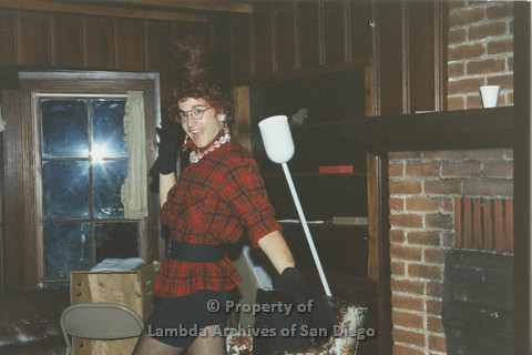 P001.201m.r.t Retreat 1991: man in drag wearing a red flannel patterned blouse