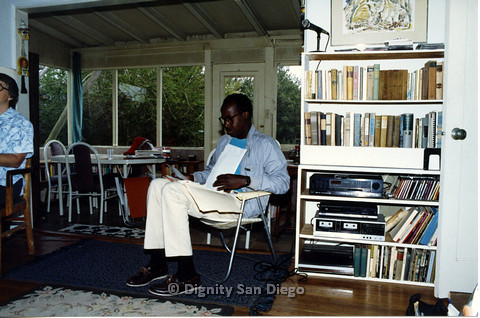 P103.081m.r.t Dignity San Diego: seated man with papers