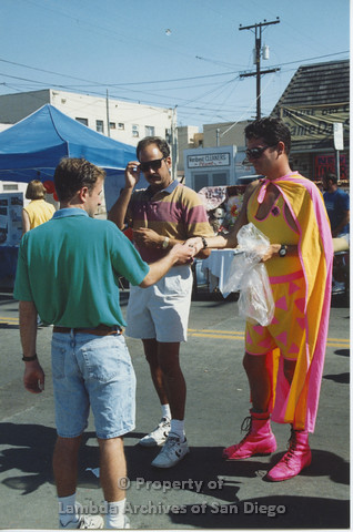 P001.096m.r City Fest 1991: 3 men, one wearing a yellow and pink costume