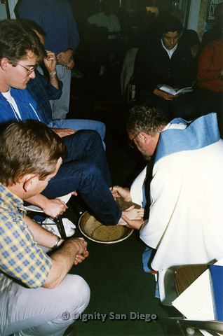 "P103.050m.r.t Dignity San Diego: ""Holy Thursday foot washing at Dignity Center, Fr. Jim Ruddy.  Rick Duffer"""