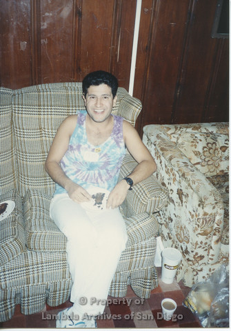 P001.180m.r.t Retreat 1991: man sitting on a couch wearing a tye-dye tank-top