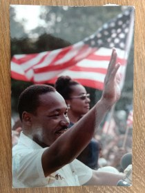 """Martin Luther King, Jr. waves to the crowd at the final rally of the """"March Against Fear"""" at the Mississippi State Capitol in Jackson Mississippi on June 1, 1966."""