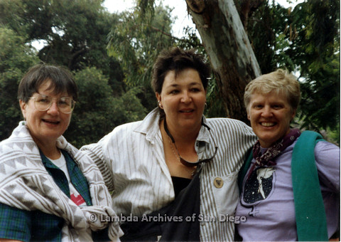 P024.501m.r.t 1989 San Diego Pride: (Left to right) Two unknown women and Sally Hopkins taking a picture