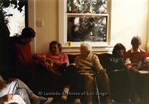 P024.333m.r.t Crestwood St: A group of women mingle on a couch.