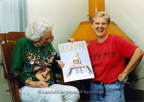 P024.334m.r.t Sally Hopkins holding a Madonna calendar.
