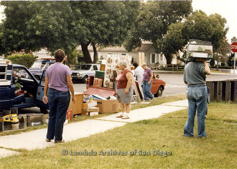 P024.345m.r.t Moving Sheila Shanahan and Nancy Groswich: Nancy Groswich (right) and Sheila Shanahan (left) moving boxes into car alongside Ila Suzanne (center), Sally Hopkins (background in purple).