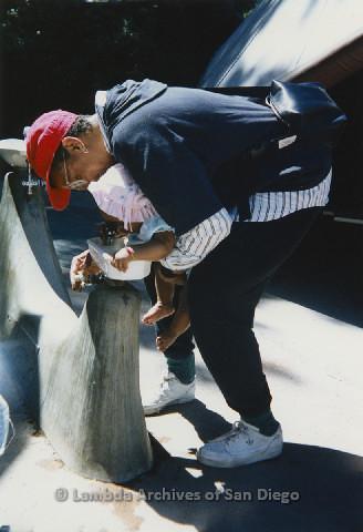 P125.016m.r.t Marti Mackey helping Nakia or Natasha Taylor drink from a water fountain