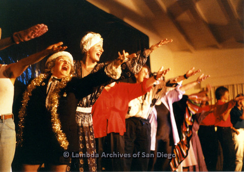 P024.187m.r.t  Cast  and Judith McConnell (center, tallest) singing with arms outstretched