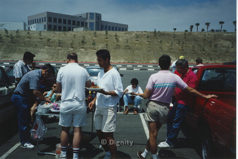 P104.073m.r.t Dignity San Diego: People eating food at a parking lot