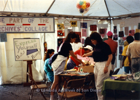 "P024.462m.r.t 1990 San Diego Pride festival: Group of people in a tent. Signs on tent wall, one reads, ""Be part of the Archives' collage!"" Another sign on easel reads, ""Express yourself, write a message"""