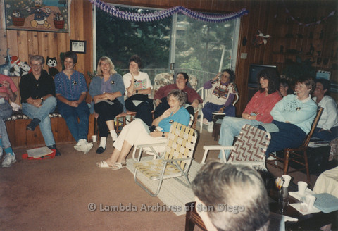 P024.379m.r.t A group of women, including Sally Hopkins (far left) and Edna Myers  (center, in rear) on a recliner, and Muriel Fisher to Myers' right sitting in a circle
