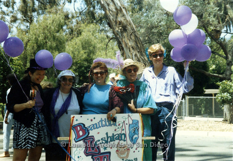 P024.473m.r.t 1990 San Diego Pride Parade: (From left to right) Kithy Gately, Muriel Fisher, Gwen Snyder, Kate Rosenblatt, and Judith McConnell behind a Beautiful Lesbian Thespians sign