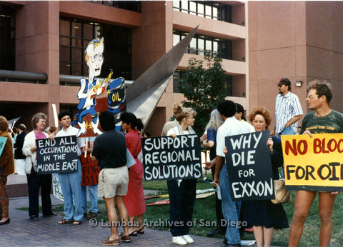"""P024.556m.r.t  People holding signs, center sign reads """"support regional solutions"""""""