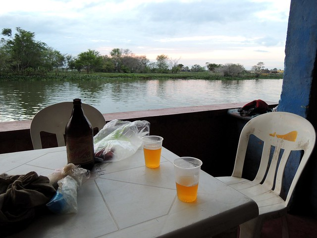 A post-swim, pre-mosquito beer.  The mosquitoes are so bad at night here that this bar closes at twilight. by bryandkeith on flickr