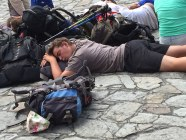 A weary pilgrim rests in the plaza outside the Cathedral in Santiago de Compostela