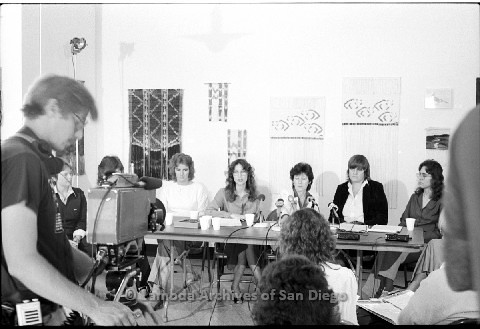P123.014m.r.t Dixon Press Conference 1982:  (Left to Right) Robin Bruce, Fran Ledford, Chris Russell, Kathy Gilberd (MLTF, NLG), Diane Cooper (NOW/SD), Susan McGreivy (ACLU), Kim McAlister (CWSS).