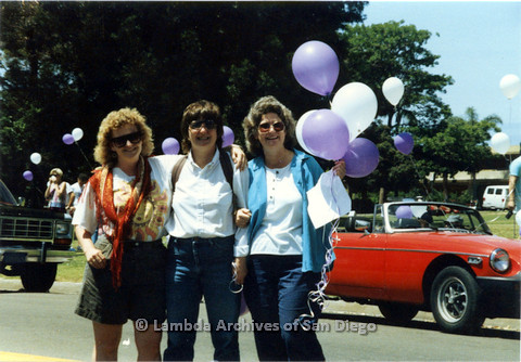 P024.532m.r.t 1990 San Diego Pride Parade: Three women in sunglasses standing in the street for a photo