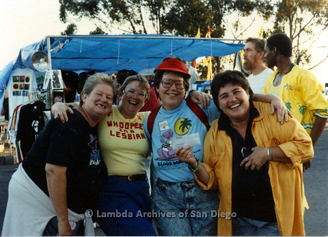 P024.494m.r.t 1990 San Diego Pride festival: (Left to Right) unknown woman, Deanna Gauthier, Kathy Moore, and unknown woman smiling for a photo
