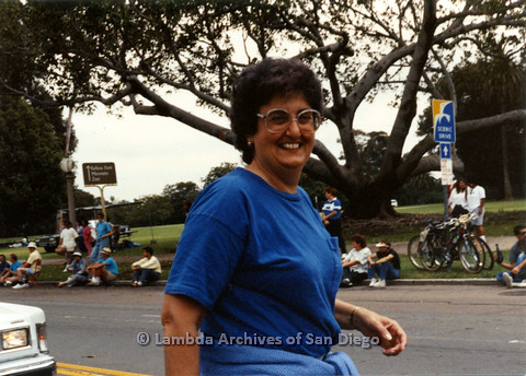 P024.447m.r.t 1990 San Diego Pride Parade: Joyce Mariel smiling in blue.
