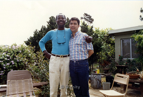 P104.185m.r.t Dignity San Diego: Stan Lewis (on left) with arm around Rick Duffer (right) standing in back yard.