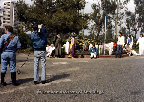 P024.544m.r.t People standing and sitting on asphalt