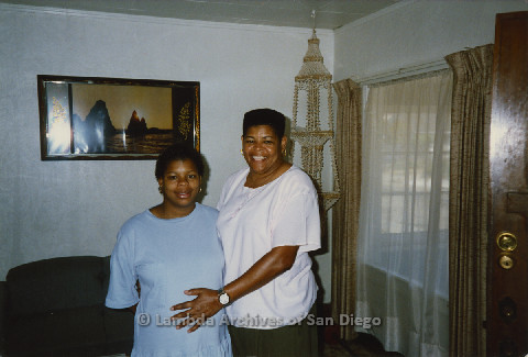 P125.033m.r.t Phyllis Jackson with hands on pregnant belly of daugher Chielo Murray