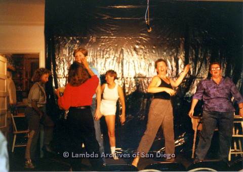 P024.155m.r.t Ellie Rapp (left) with Judith McConnell in light blue, Diane F. Germain in white tank top, and Kithy Gately in black tank top rehearsing on stage