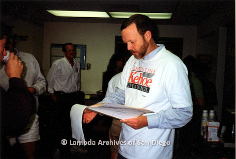 P151.032m.r.t Charlie McKain reading documents in campaign office