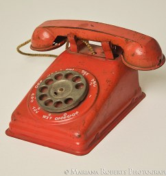 vintage toy telephone red metal rotary dial phone from the 1950s the steel stamping [ 1024 x 995 Pixel ]