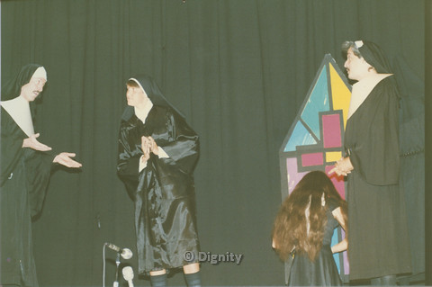 P104.062m.r.t Dignity San Diego: Three people in nun habits and a person acting on stage