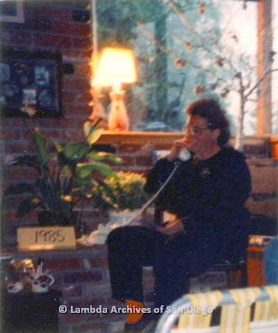 P024.388m.r.t  A seated woman holding a telephone
