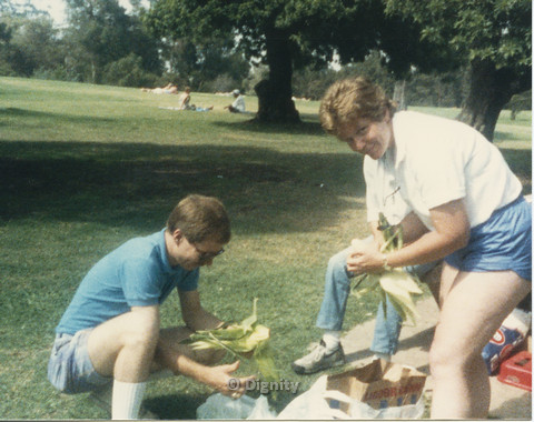 P104.059m.r.t Dignity Picnic 4th of July: Man and woman handling corn husks