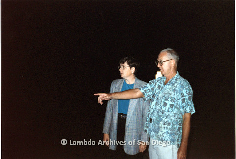 P151.024m.r.t Christine Kehoe and a man with glasses in blue shirt pointing