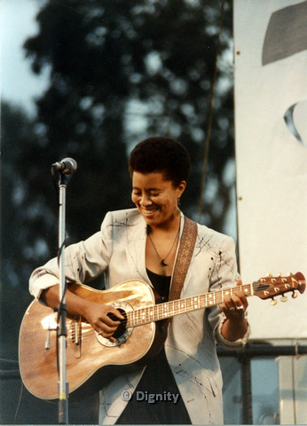 P104.158m.r.t San Diego Pride Festival 1989: Deidre McCalla playing guitar on stage.