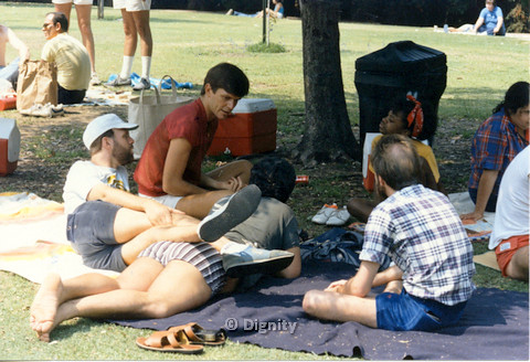 P104.048m.r.t Dignity Picnic 4th of July: Group of people sitting at the park, under the shade