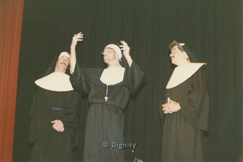 P104.063m.r.t Dignity San Diego: Three people in nun habits acting on stage (middle possibly Bruce Neveu?)