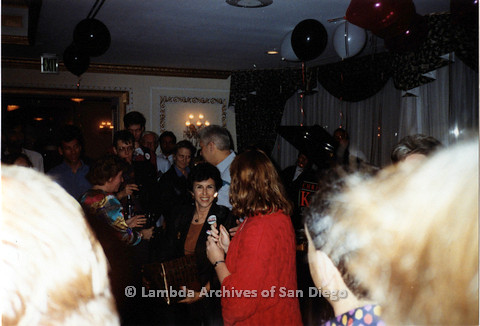 P151.033m.r.t A crowd of people at an indoor party