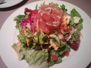 salad with raw ham