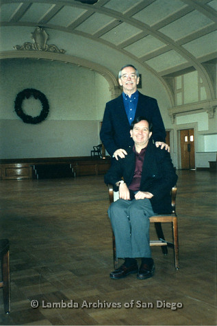 P022.052m.r.t The Center, Centre Street (Craftsmen Hall): One man standing behind another man sitting on a chair