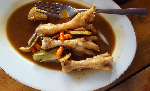 I saw something new on the menu -- I recognized the name of the sauce: rica rica, but what a surprise when the chicken feet arrived at our table! by bryandkeith on flickr