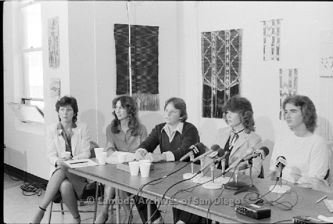 P123.033m.r.t Dixon Press Conference 1982:  (Left to Right) Diane Cooper (NOW/SD), Kathy Gilberd (MLTF, NLG), Robin Bruce, Fran Ledford, and Chris Russell looking towards audience.