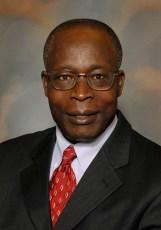 Mbaku, John M
