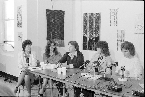 P123.035m.r.t Dixon Press Conference 1982:  (Left to Right) Diane Cooper (NOW/SD), Kathy Gilberd (MLTF, NLG), Robin Bruce, Fran Ledford, and Chris Russell looking towards audience.