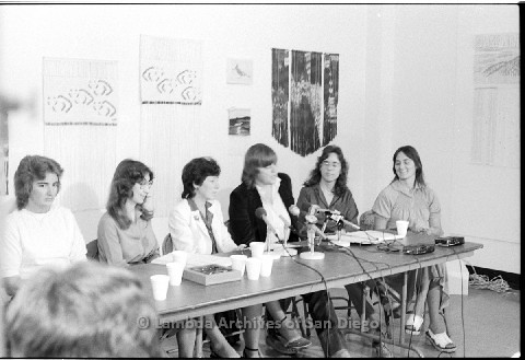 P123.011m.r.t Dixon Press Conference 1982:  (Left to Right) Chris Russell, Kathy Gilberd (MLTF, NLG), Diane Cooper (NOW/SD), Susan McGreivy (ACLU), Kim McAlister (CWSS), Eileen Bingle listening while Susan speaks.