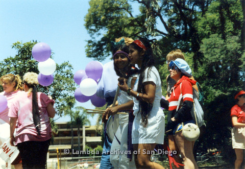 P024.478m.r.t 1990 San Diego Pride Parade: Two women with bandanas