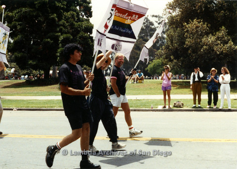 P024.414m.r.t 1990 San Diego Pride parade: unidentified people marching in parade