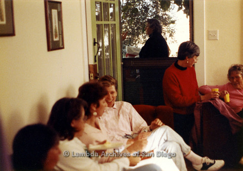 P024.332m.r.t Crestwood St: A group of women mingle on couches.